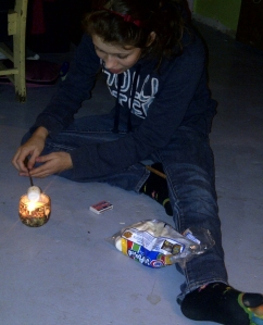 roasting marshmallows over candle